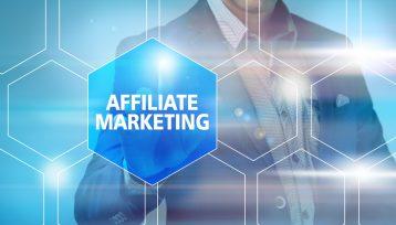 Businessman pressing affiliate marketing button on virtual scree